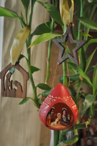 Besides the five nativities with movable figures, I also have several small, fixed nativity ornaments or sets. Here are two of my favorites (plus a star) that I have hanging on my bamboo plant next to my kitchen sink (I haven't managed to kill it yet!). My sister bought the dark wood ornaments for me in Africa, and on a recent trip to Ten Thousand Villages I treated myself to the carved gourd nativity made in Peru. So beautiful!