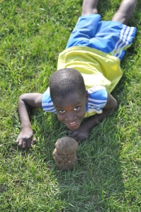 And here's one of my crazy boy with a dirt clod he found at a soccer game last week.