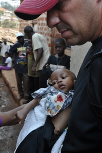 This little girl was put in Dave's arms in the slums.