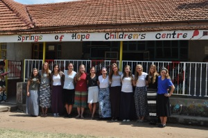 The girls (minus one--still inside with a child) in front of Springs of Hope