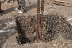 Holes for the concrete foundation for Springs of Hope's permanent home. These were dug by hand!
