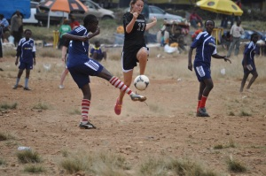 We had a few scraped knees and elbows, but amazingly no big injuries (either team) playing on KIbera's slanted dirt-and-rocks field.