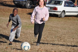 Patrick and Maddie chasing down a ball during a fierce game of soccer at my sister's house last fall.