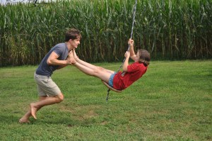 Cousin Seth giving Maddie a ride on their tree swing--always a huge hit!
