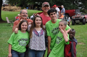 My kids with cousin Michael and Uncle Dan (back left) and one of their friends just after the five kids went zip-lining.